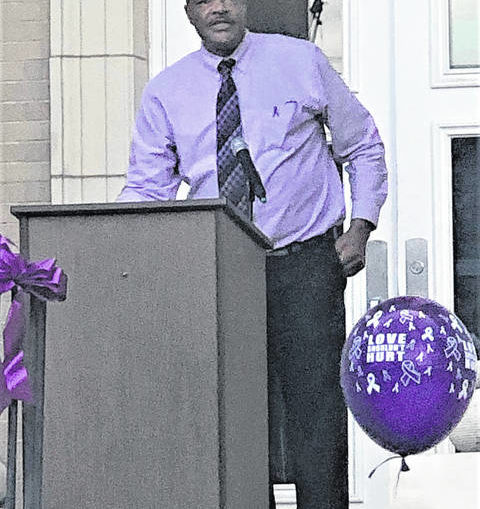 Coalition honors domestic violence victims through vigil
