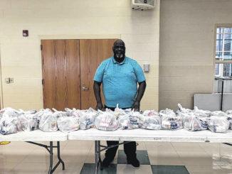 Wadesboro Primary School Principal Fred Davis delievers snack bags to students.